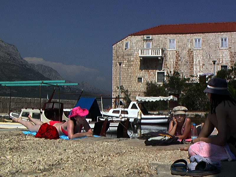Sunbathers in Mandrac (Monastery in the background)