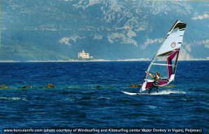 Windsurfer and Vela Sestrica lighthouse in the background