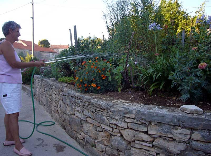 Neda watering her garden