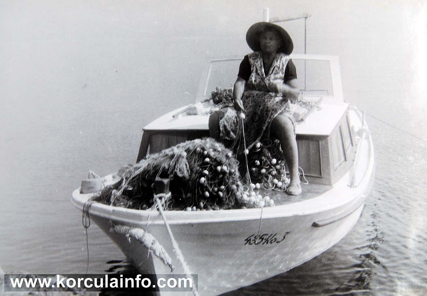 Teta Stefa - local fisherwoman in her boat with her fishnets - Korcula (1970s)