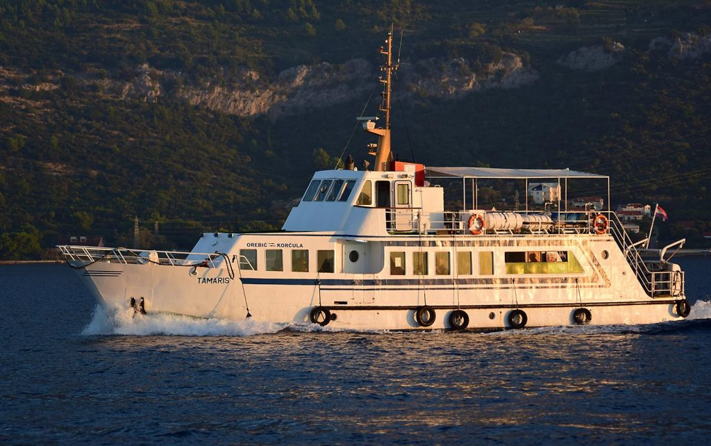 Small foot passenger ferry Tamaris sailing across the channel between Orebic and Korcula